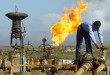(FILES) -- File picture dated January 19, 2004 shows a worker turning a valve at the Shirawa oil field, where oil was first pumped in Iraq in 1927, outside the northern city of Kirkuk. No companies submitted bids to work on the Baghdad East oil field or the cluster of fields known as Eastern Fields as part of an Iraqi auction of its energy resources on December 11, 2009, Oil Minister Hussein al-Shahristani said. Meanwhile, Iraq reached agreement with energy giants Shell and Petronas for the massive Majnoon southern oil field, while a consortium led by China's CNPC was awarded the contract for Iraq's Halfaya oil field at an auction in Baghdad, the oil minister said. AFP PHOTO/Karim SAHIB
