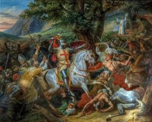 """Bataille de las navas de Tolosa, le 16 juillet 1212 par Horace Vernet, tableau commandé en 1817, c'est-à-dire avant la conception même des salles des croisades. Cinq grandes salles, situées au rez de chaussé de l'aile nord du château, ont été dédiées aux croisades par Louis Philippe dans le cadre du musée """"à toutes les gloires de la France"""". Elles sont les dernières chronologiquement de l'œuvre politique et didactique voulue par le roi, et représentent le plus bel exemple de style """"néogothique """" français. Les tableaux qui y sont présentés n'ont aucun rapport avec une vérité historique telle que nous la concevons aujourd'hui, mais témoignent brillamment de la manière dont l'orient et la chevalerie étaient rêvés à l'époque."""