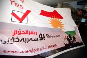 A man holds a printed banner of Kurdistan region referendum in Erbil, Iraq August 26, 2017. Picture taken August 26, 2017. REUTERS/Azad Lashkari